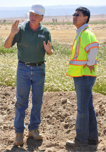 CAWSC hydrologist John Izbicki and T.J. Kim, Chief Engineer for the LA County Department of Public Works, discuss a recharge-pon